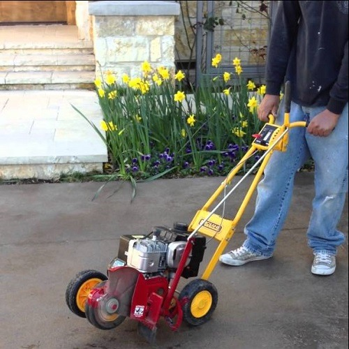 McLane 801 5.50GT Gas Powered Lawn Edger on a Driveway