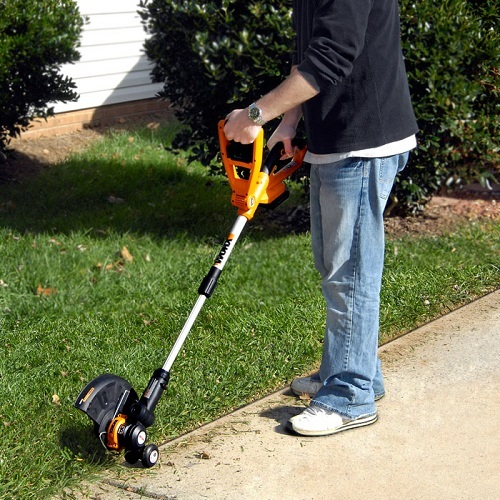 Man Using an Electric Lawn Edger