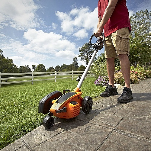 Man Using WORX WG 896 12 Amp 2-in-1 Electric Lawn Edger