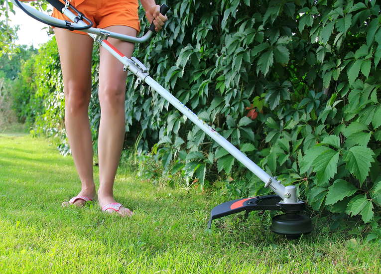 What is the difference between a Lawn Edger and a String Trimmer - EdgeMyLawn